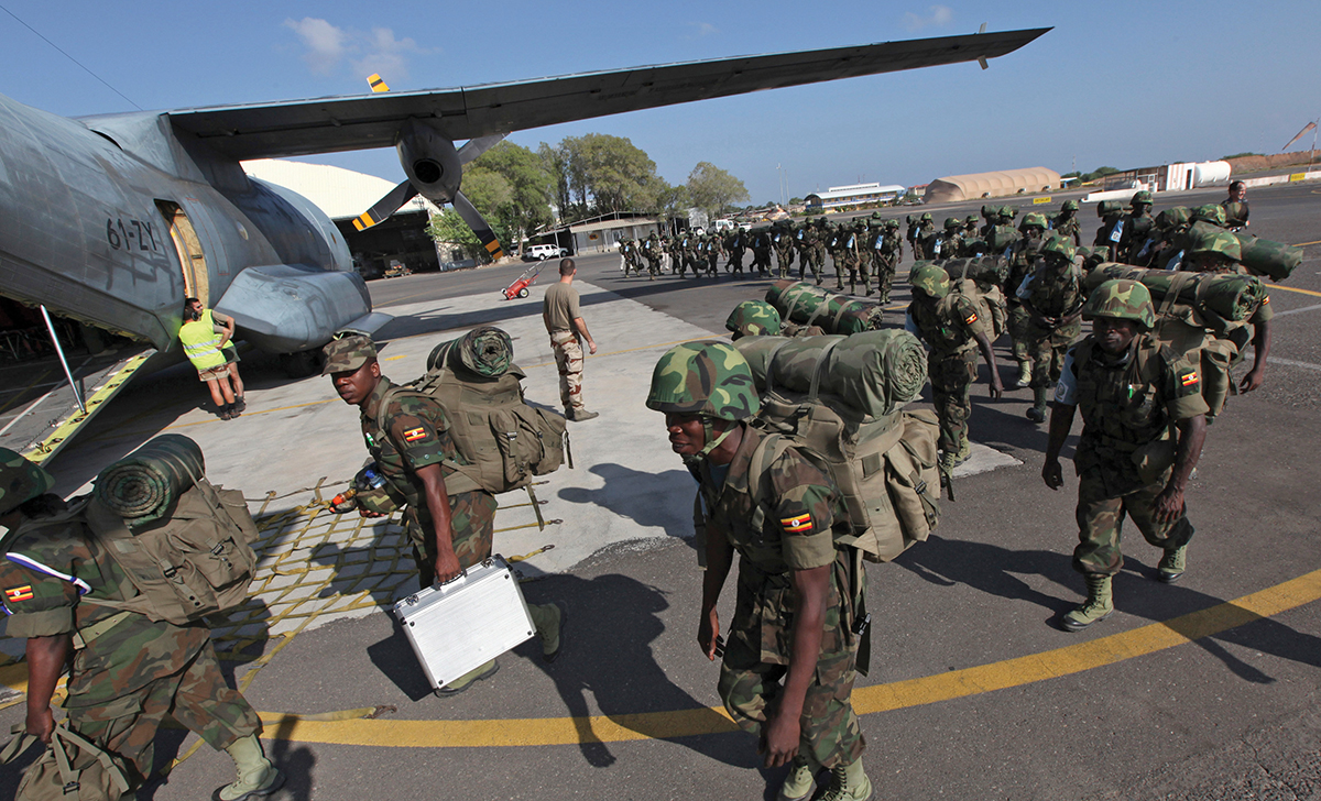 Members of the EASB from Uganda queue to board a French tactical aircraft C160 Transall at the French Air Base 188 in Djibouti