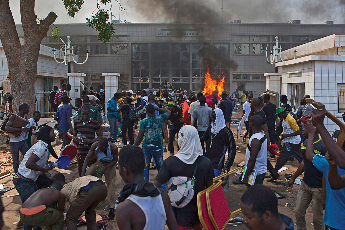 Anti-government protesters set fire to the parliament building in Ouagadougou