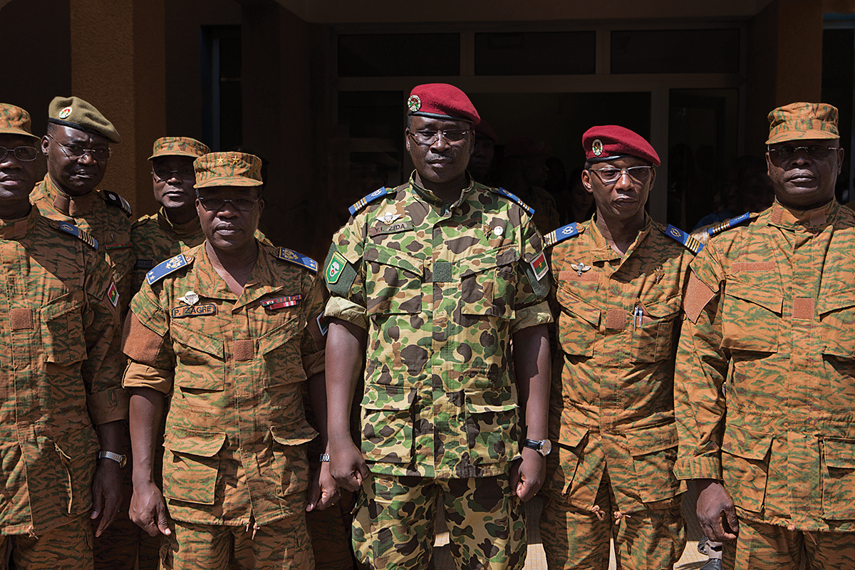 Lieutenant Colonel Isaac Zida poses for a picture after a news conference in which he was named president at military headquarters in Ouagadougou