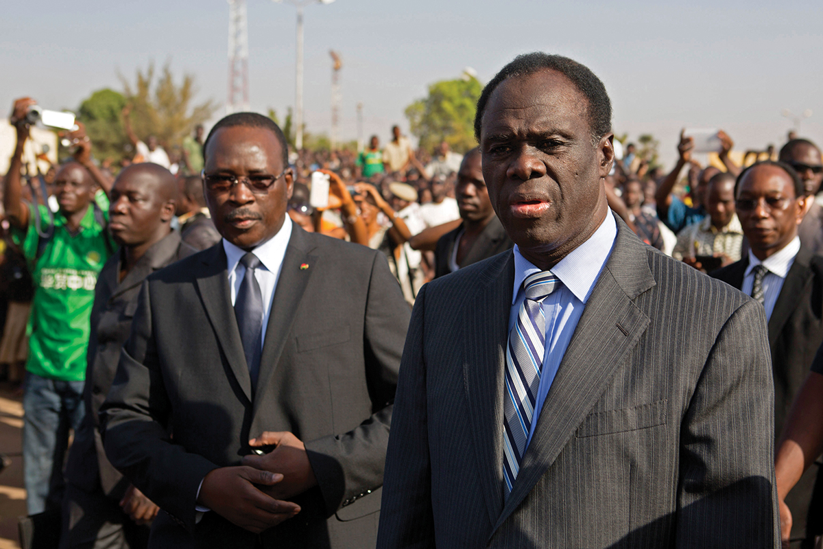 Burkina Faso President Michel Kafondo and PM Isaac Zida arrive at a memorial service for six people who died during the recent popular uprising in Ouagadougou