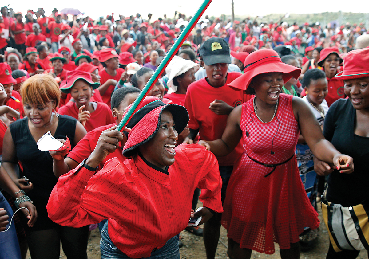 Supporters of the Democratic Congress party chant slogans in the capital Maseru