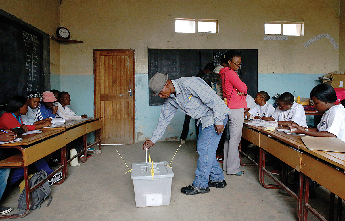 Man casts his vote during Lesotho's national election in Qoaling village