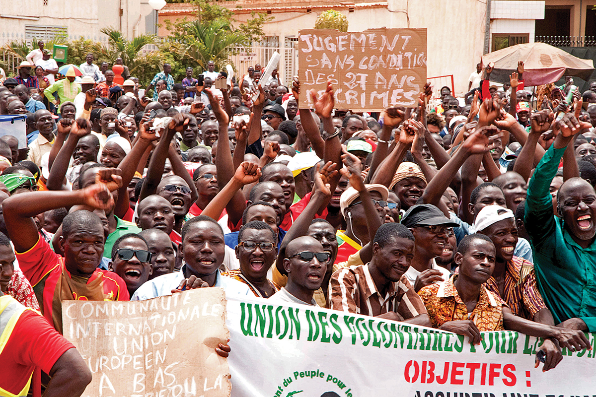People gather at a rally in support of a law that prohibits the candidature of anyone who supported ousted president Blaise Compaore in the upcoming presidential elections, Ouagadougou