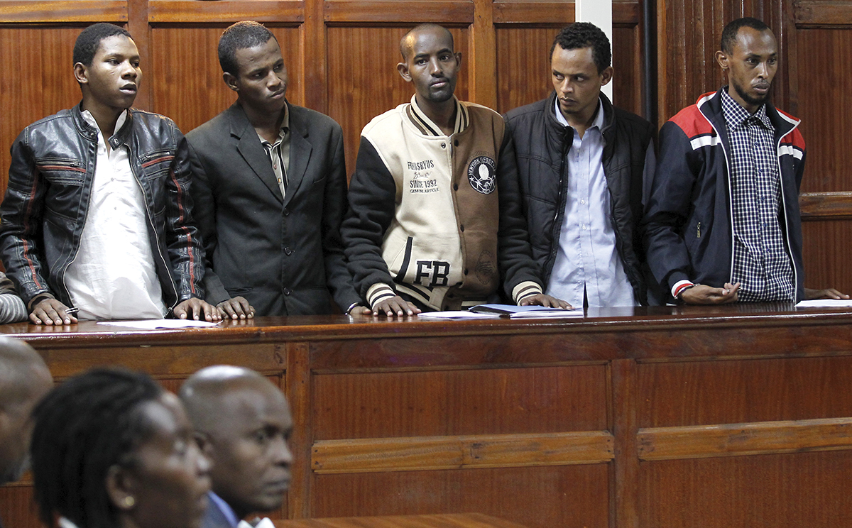 Suspects stands inside the dock at the Milimani Law Courts in Kenya's capital Nairobi