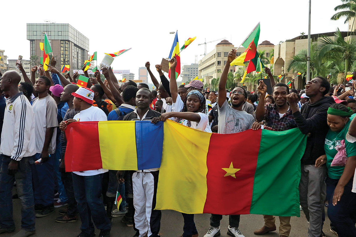 People holding Chadian and Cameroonian flags