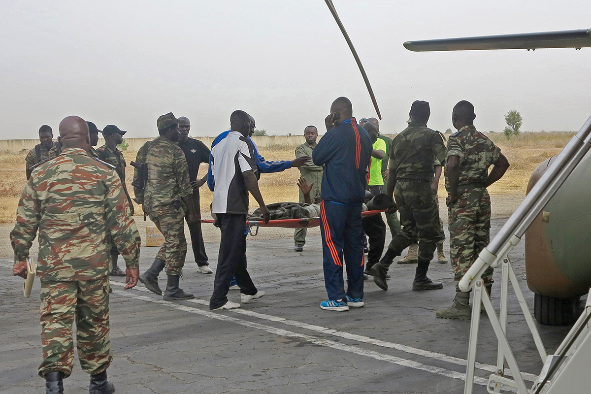 Military personnel evacuate a Cameroonian soldier